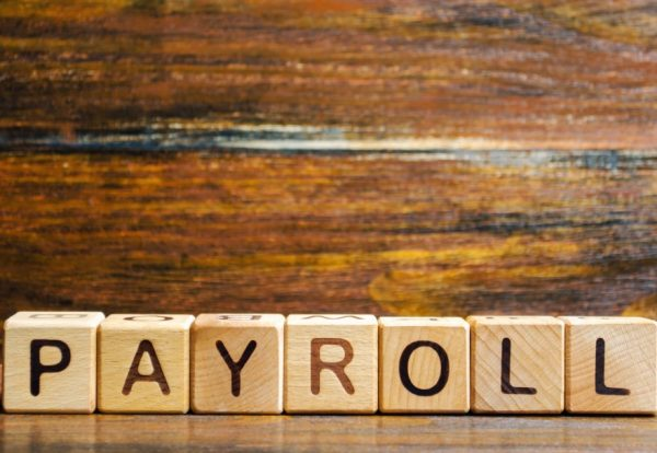 wooden-blocks-with-the-word-payroll-payroll-is-the-sum-total-of-all-compensation-a-business-must-pay_t20_pRXPv1